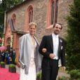 Nikolaos et Tatiana de Grèce assistaient, le 18  juin 2011, au mariage religieux de la princesse Nathalie de  Sayn-Wittgenstein-Berleburg et d'Alexander Johanssmann, en l'église  protestante de Bad Berleburg, en Allemagne.