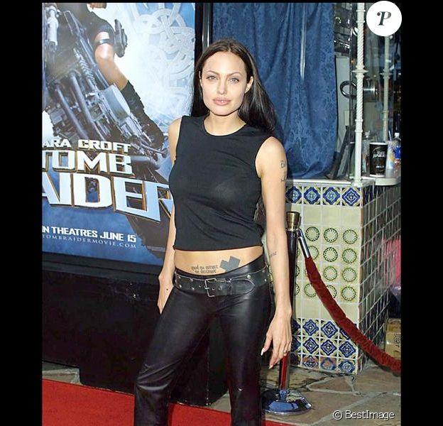 Angelina Jolie a connu le succès au cinéma avec Tom Raider mais côté look, elle a encore beaucoup à faire ! Los Angeles, 11 juin 2001