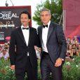 George Clooney en Armani et Grant Heslov lors de l'avant-première du film Les Marches du pouvoir en ouverture du festival de Venise le 31 août 2011