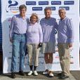 Philippe et Claire Doucet, Nelson Monfort et Guy Vassel lors du trophée Novotel des personnalités au golf à Guyancourt le 15 octobre 2011