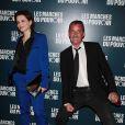 Juliette Binoche et Christophe Dechavanne à la projection du film de George Clooney Les Marches du pouvoir, à Paris. 18 octobre 2011