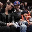 Swizz Beatz et sa femme Alicia Keys, avec leur fils Egypt le 25 décembre 2011 au Madison Square Garden à New York