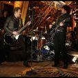 Johnny Hallyday et Yarol Poupaud lors du concert privé donné à la tour Eiffel, le 3 décembre 2011.
