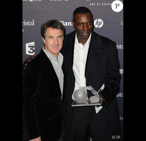 François Cluzet et Omar Sy lors des Globes de cristal le 6 février 2012
