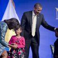 Barack et Michelle Obama lors d'une soirée à Washington pour célébrer l'ouverture à venir d'un nouveau musée dédié à la culture afro-américaine. Le 22 février 2012