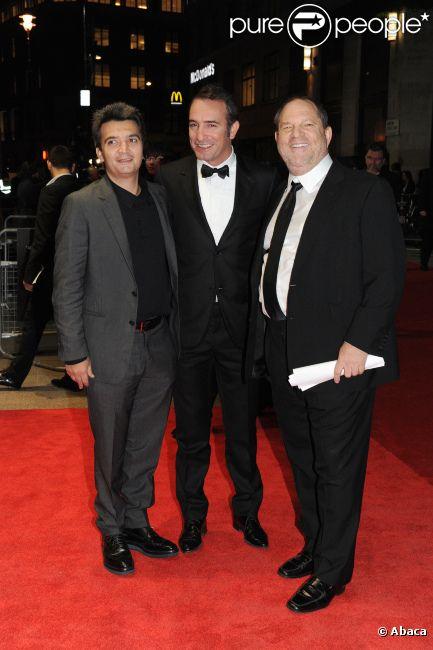 Thomas Langmann, Jean Dujardin et Harvey Weinstein en octobre 2011 à Londres.