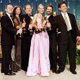 Harvey Weinstein, Gwyneth Paltrow et le réalisateur John Madden lors du sacre de  Shakespeare in Love  aux Oscars en 1999 - le film a gagné 7 statuettes.