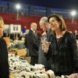 Albert et Caroline de Monaco découvrent la kermesse organisée par l'oeuvre de Soeur Marie, dans le quartier de Fontvieille à Monaco, le 16 mars 2012.