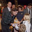 Caroline de Monaco, resplendissante, découvre la kermesse organisée par l'oeuvre de Soeur Marie, dans le quartier de Fontvieille à Monaco, le 16 mars 2012.