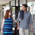 Alyson Hannigan, enceinte de son deuxième enfant, et son mari Alexis Denisof, à Los Angeles, le 5 mai 2012