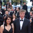 Philippe Caroit et sa femme lors de la montée des marches le 21 mai 2012 dans le cadre du Festival de Cannes lors de la présentation du film d'Alain Resnais Vous n'avez encore rien vu