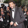 Ramzy Bédia le 21 mai 2012 lors de la montée des marches pour la présentation du film Vous n'avez encore rien vu dans le cadre du 65ème Festival de Cannes