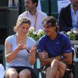 Kim Clijsters et Rafael Nadal le 24 mai 2012 à Roland Garros lors d'un essai pour les nouvelles raquettes intelligentes signées Babolat