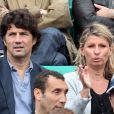 Bruno Madinier et sa femme le 3 juin 2012 à Roland-Garros