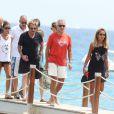 Johnny Hallyday et Laeticia, accompagnés de Gilbert Coullier et Nicole, arrivent à la plage de Tahiti entre Saint-Tropez et Ramatuelle, le 20 juillet 2012.