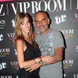 Christian Audigier et sa compagne Nathalie font la fête au VIP Room de Jean-Roch, le samedi 28 juillet 2012. Le styliste y lançait sa marque Lady Baltimore.