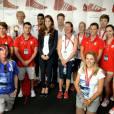 Kate Middleton et le prince Harry le 9 août 2012 au village olympique des JO de Londres pour féliciter les athlètes du Team GB, auteurs d'une moisson record de médailles.