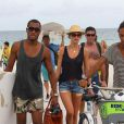Doutzen Kroes et son mari Sunnery James rentrent d'une journée à la plage. Le 15 août 2012 à Miami