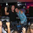 Sébastien Cauet et son ami Stéphane Plaza s'amusent comme des petits fous au VIP Room de Saint-Tropez, le dimanche 26 août 2012.