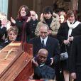 Lola et Renato, petits-enfants d'Annie, Giulia sa fille, quittant l'église Saint-Roch à Paris où se sont déroulées les obsèques d'Annie Girardot le 4 mars 2011
