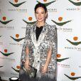 Lucy Liu complète son allure couture avec un manteau signé Roberto Cavalli. New York, le 9 Novembre 2012.
