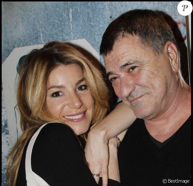Jean-Marie Bigard et sa femme Lola lors du vernissage de l'exposition des photos de Valérie Perron, 9 janvier 2012 à Paris.
