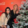 Elise Chassaing et Enora Malagré lors de l'inauguration des vitrines de Noël Coca-Cola au Showcase à Paris le 26 Novembre 2012