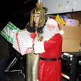Heidi Klum et le Père Noël lors de la soirée du Noël Hanté en faveur de la Croix-Rouge américaine, le 1er décembre 2012 à New York