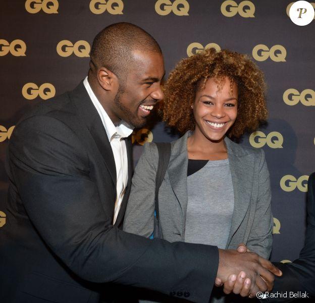Teddy Riner et sa douce Luthna avec Denzel Washington lors de la soirée GQ Les Hommes de l'année 2012, à Paris le 16 janvier 2013