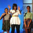 La première dame Michelle Obama et ses filles Sasha et Malia lors du Kids Inaugural Concert à Washington le 19 janvier 2013