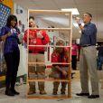 Barack Obama et sa femme Michelle retroussent leurs manches et participent au National Day of Service, journée de bénévolat, dans une école de Washington, Burrville Elementary School, le 19 janvier 2013