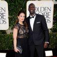 Omar Sy discret avec sa femme lors des Golden Globes, le 13 janvier 2013.