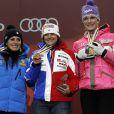 Marion Rolland accompagnée sur le podium de Nadia Fanchini et Maria Höfl-Riesch est devenue championne du monde de descente à Schladming en Autriche le 10 février 2013