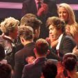 Exclusif - Le groupe One Direction (Harry Styles, Niall Horan, Louis Tomlinson, Zayn Malik, Liam Payne) à table accompagnés de James Corden lors de la cérémonie des BRIT Awards à Londres, le 20 février 2013.
