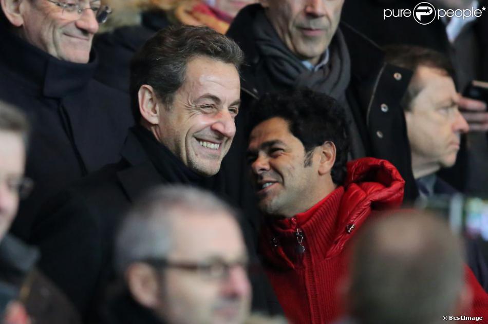 Nicolas Sarkozy et Jamel Debbouze lors du match entre le Paris Saint-Germain et l'Olympique de Marseille (2-0) au Parc des Princes à Paris le 24 février 2013