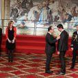 Valérie Trierweiler, Francois Hollande et Tony Estanguet lors de la cérémonie de remise de la Légion d'honneur aux sportifs médaillés à Londres lors des Jeux olympiques, au palais de l'Elysée le 1er mars 2013 à Paris