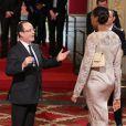 François Hollande et Sandrine Gruda lors de la cérémonie de remise de la Légion d'honneur aux sportifs médaillés à Londres lors des Jeux olympiques, au palais de l'Elysée le 1er mars 2013 à Paris