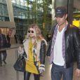 La chanteuse Fergie (enceinte) et son mari Josh duhamel arrivent a l'aéroport Heathrow de Londres, le 19 fevrier 2013.