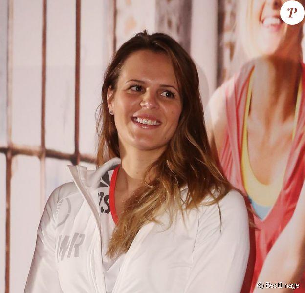 Laure Manaudou rayonnante lors d'un événement organisé par Reebok au Pure Club Med Gym de Bastille à Paris le 19 mars 2013