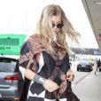 Fergie, enceinte, prend l'avion a Los Angeles à destination de New York, le 20 mars 2013.