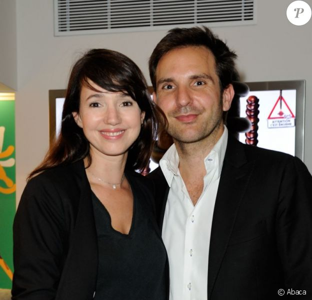 Christophe Michalak et sa compagne Delphine McCarty, à la soirée Mikado King Choco au concept store Colette store, à Paris le 24 mai 2012.