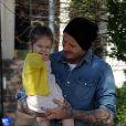 David Beckham et sa fille Harper dans les rues de Notting Hill à Londres. Le 24 avril 2013.