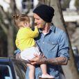 David Beckham et sa fille Harper se promènent à Londres, le 24 avril 2013.