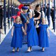Les princesses Catharina-Amalia (9 ans), Alexia (7 ans) et Ariane (6 ans), filles du roi Willem-Alexander et de la reine Maxima des Pays-Bas, menaient le cortège de la famille royale néerlandaise (avec notamment la princesse Beatrix et la princesse Mabel derrière elles) à leur arrivée à la Nouvelle Eglise d'Amsterdam pour la prestation de serment de Willem-Alexander, le 30 avril 2013.