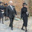 La reine Margrethe II de Danemark et le prince consort Henrik aux obsèques du comte Christian de Rosenborg, ancien prince de Danemark, le 29 mai 2013 à l'église et au cimetière de Lyngby. Outre sa veuve Anne Dorte et leurs trois filles, la reine Margrethe II de Danemark, le prince Henrik, la princesse Benedikte et la princesse Marie assistaient à l'office, conduit par Julie Schmidt.