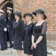 Les trois filles du défunt, lors des obsèques du comte Christian de Rosenborg, ancien prince de Danemark, le 29 mai 2013 à l'église et au cimetière de Lyngby. Outre sa veuve Anne Dorte et leurs trois filles, la reine Margrethe II de Danemark, le prince Henrik, la princesse Benedikte et la princesse Marie assistaient à l'office, conduit par Julie Schmidt.