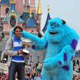Comme après chaque victoire à Roland-Garros, Rafael Nadal est allé le lendemain de son triomphe dans l'édition 2013 fêter son succès à Disneyland Paris, le 10 juin 2013.