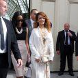 Rihanna et son amie Melissa Forde lors du défilé Chanel Haute Couture à Paris le 2 juillet 2013