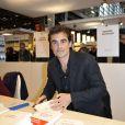 Raphaël Enthoven au Salon du livre à la porte de Versailles à Paris le 24 mars 2013.