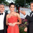 Sandra Bullock et George Clooney avec Alfonso Cuaron à la cérémonie d'ouverture et la présentation de Gravity à la 70e Mostra de Venise, le 28 août 2013.